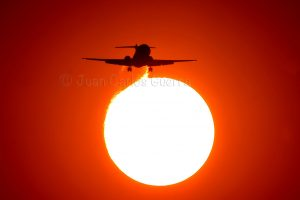Sunset shot of a plane approaching runway 05L
